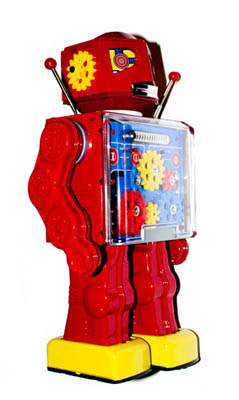A classic sixties-era retro-style diecast metal toy robot, with visible gears in its chest cavity